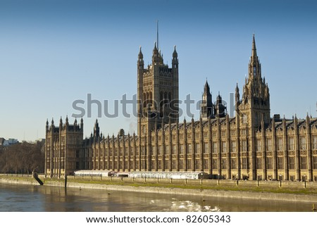Palace of Westminster, London. It is the meeting place of the two houses of the Parliament of the United Kingdom. It lies on the north bank of the River Thames.
