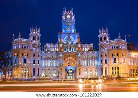 Palacio de Comunicaciones at Plaza de Cibeles illuminated at night in the city of Madrid, Spain - stock photo