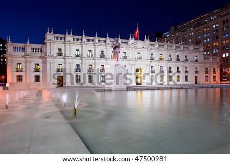 "Palacio de la Moneda, ""La Moneda"", Chile's presidential and government palace, designed on Neoclassical style by architect Joaquin Toesca, downtown civic center, Santiago, Chile, South America - stock photo"