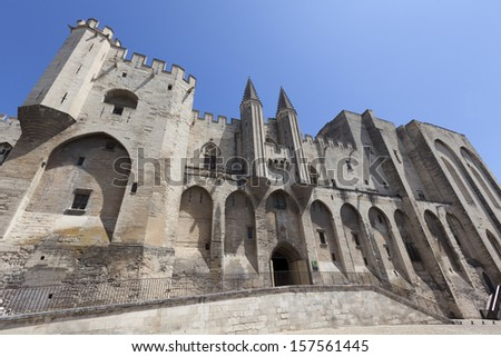 Palais des Papes - Palace of the Popes in Avignon, South East France. Europe. Blue Sky. - stock photo