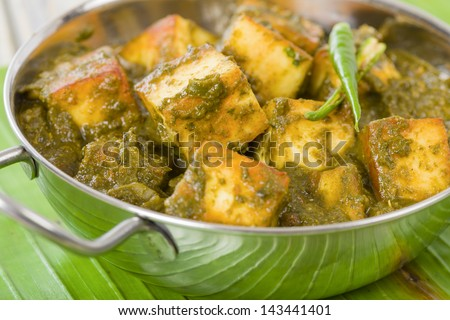 Palak Paneer - South Asian curry made with paneer (cheese) with pureed spinach sauce. Close up. - stock photo
