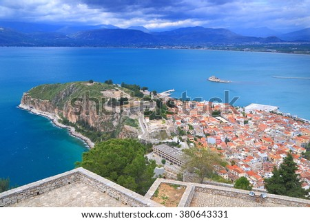 Palamidi fortress and distant town of Nafplio in stormy day, Greece - stock photo