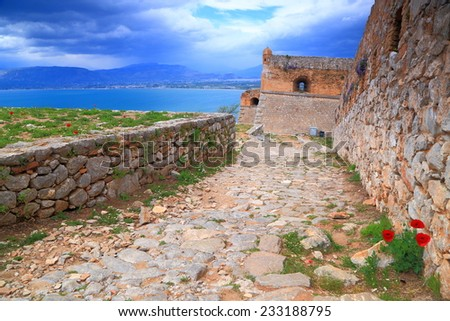 Palamidi fortress surrounded by the Mediterranean sea in cloudy day, Nafplio, Greece