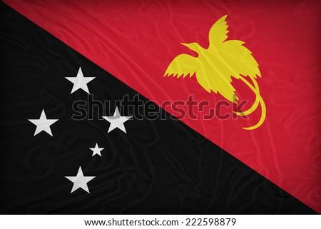 Palau New Guinea flag pattern on the fabric texture ,retro vintage style - stock photo