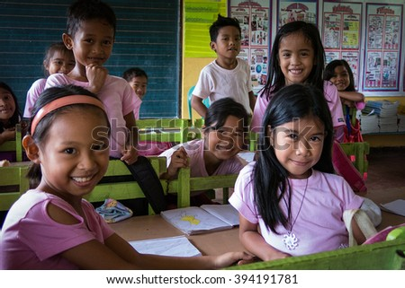 PALAWAN, PHILIPPINES - AUG 22: School children attending class at Paaralang Elementary School on the Island of Palawan in the Philippines on Aug 22, 2014.  - stock photo