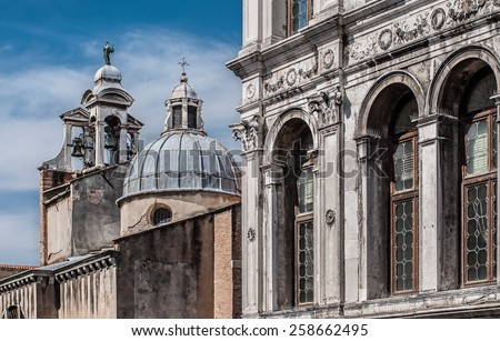 Palazzo dei Camerlenghi windows (renaissance palace) and campanile of catholic church San Giacomo di Rialto (San Giacometo), Venice, Veneto, Italy - stock photo