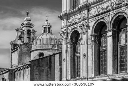 Palazzo dei Camerlenghi windows (renaissance palace) and campanile of catholic church San Giacomo di Rialto (San Giacometo), Venice, Italy. Black and white photography. - stock photo