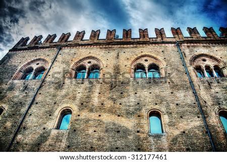 Palazzo dei Notai in Bologna under a dramatic sky, Italy - stock photo