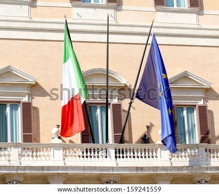 Palazzo Montecitorio headquarters of the Italian Parliament in Rome with the Italian flag and the European - stock photo