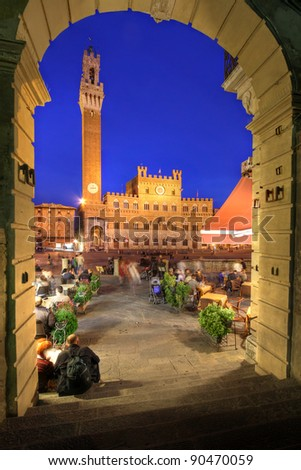 Palazzo Publica and Piazza del Campo at night, Siena, Italy - stock photo