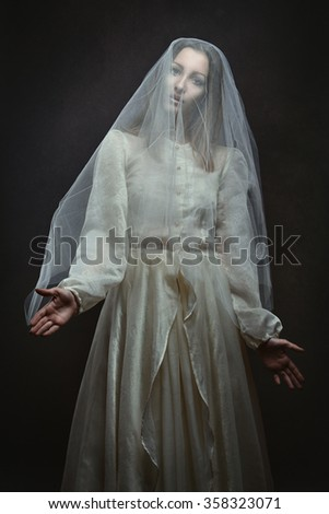 Pale beautiful woman posing like a puppet . Surreal and dark - stock photo