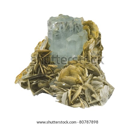 Pale blue Aquamarine crystal, with mica, isolated on white. - stock photo