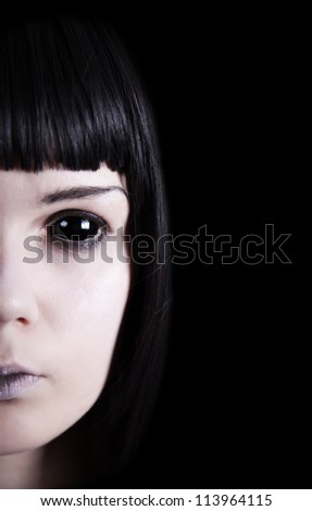 Pale ghost with black eyes, isolated on black background - stock photo