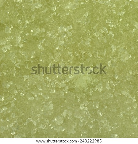 Pale green lime juicy slice covered with sweet sugar crystals macro close up - stock photo