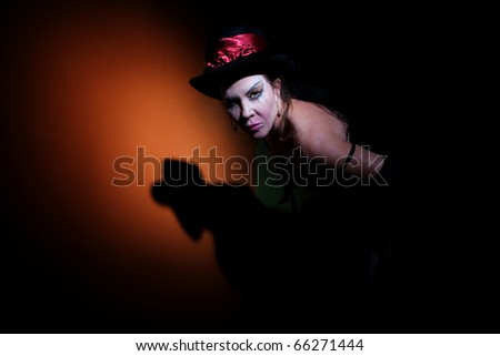 Pale looking woman dressed in black in shadows - stock photo