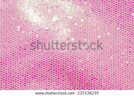 Pale pink sequin fabric background - stock photo