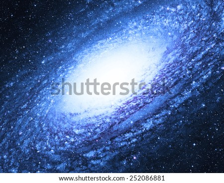 Pale Spiral Galaxy - Elements of this Image Furnished by NASA - stock photo