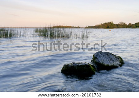pale sunlight shines through mist and fog at Lough Ennell, Co.Westmeath, Ireland - stock photo