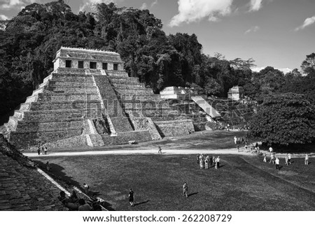 PALENQUE, MEXICO - MARCH 20, 2011: People at mayan ruins with Palace and observatory. It is one of the best preserved sites, which contains interesting architecture and is popular tourist attraction