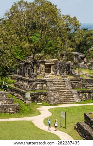 PALENQUE, MEXICO - March 18,2014: tourists in Palenque ruins, Chiapas, Mexico. Palenque was a Maya city state in southern Mexico that flourished in the 7th century. - stock photo