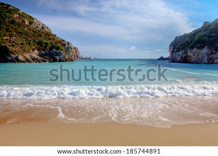 Paleokastritsa beach on Corfu, Greece, looking out between the two headlands. - stock photo