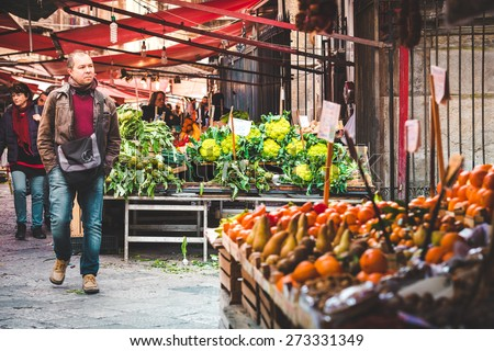 PALERMO, ITALY - MARCH 13, 2015:  Grocery shop at famous local market Ballaro in Palermo, Italy
