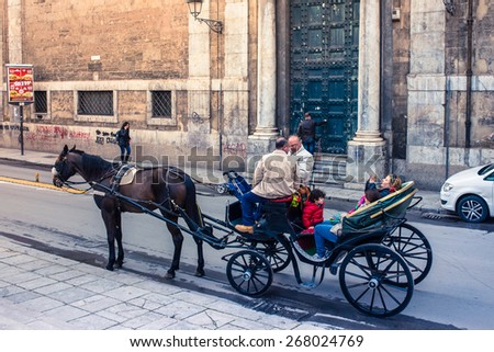 PALERMO, ITALY - MARCH 14, 2015: Horse carriage for tourists on one of main streets in old centre of Palermo, Italy