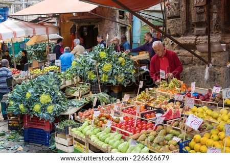 PALERMO, ITALY - OCTOBER 23, 2014: Customers and sellers on Ballaro farmer's market on the streets of old Palermo city center, around Plaza Carmine. It is the oldest of Palermo's Arabic markets.