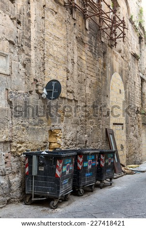 PALERMO, ITALY - OCTOBER 23, 2014: Garbage in trash bins in and around plastic containers on the streets of Palermo, Italy. Palermo has reputation of one of dirtiest cities in Italy. - stock photo