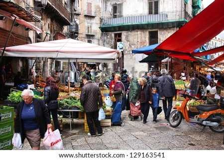 PALERMO, ITALY - OCTOBER 24: People shop at local market on October 24, 2009 in Palermo, Italy. Palermo is the 5th most populated area in Italy and the most populated on the island of Sicily. - stock photo