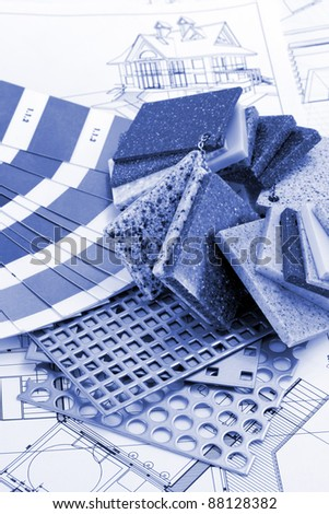 palette designs for interior works, samples of plastics, PVC, for furnishing, artificial stone, perforated metal, coated with a polymer and architectural plans for houses - stock photo
