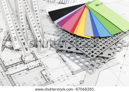 palette of color samples of plastics, PVC, for furnishing, metric folding ruler, perforated metal, coated with a polymer and architectural plans for houses - stock photo