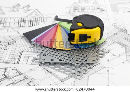 palette of color samples of plastics, PVC, for furnishing, perforated metal, coated with a polymer, architectural plans for houses & tape measure - stock photo