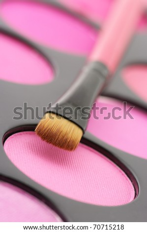Palette of colorful blushes and brush close-up. - stock photo