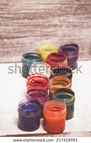 palette of colors on wooden background