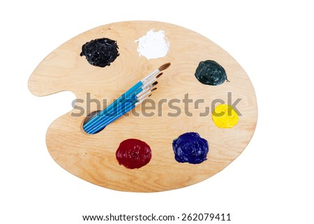 Palette with oil paint and brushes, on white background. - stock photo