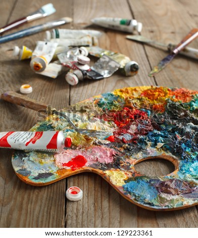 Palette with oil paint and palette-knife. - stock photo
