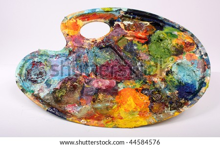 Palette with paint - stock photo