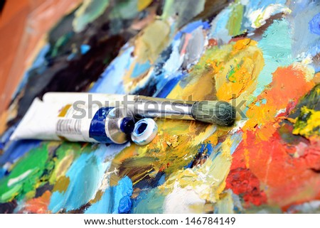 Palette with paint brush and tubes of oil paint
