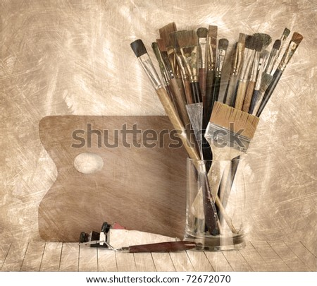 Palette with paintbrush and a paint - stock photo