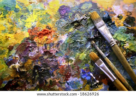 palette with paintbrushes - stock photo