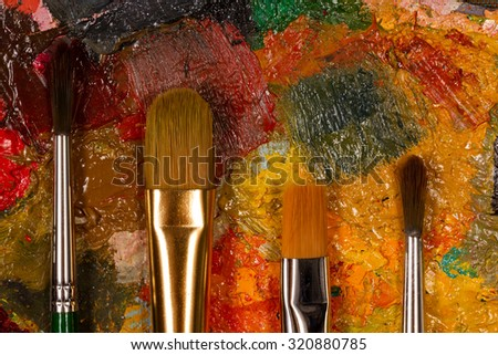 palette with set of brushes. colors of autumn. Set of the artist. Painting for design studio , bar or restaurant - stock photo