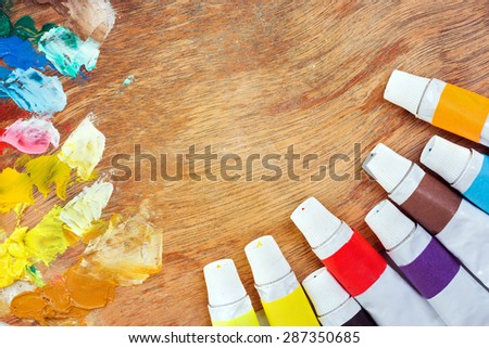 palette with tubes of paint - stock photo