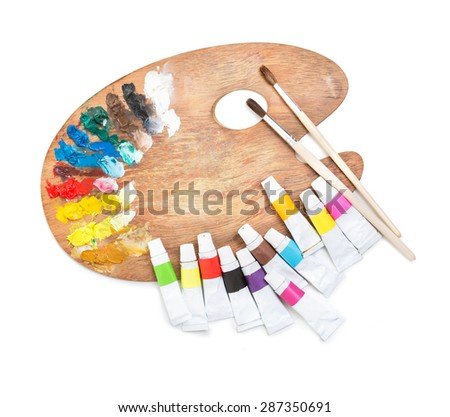 palette with tubes of paint and brushes on a white background - stock photo