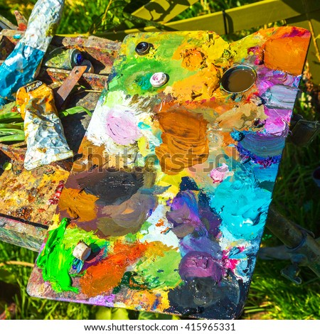 Palette - wooden board for mixing art paints - stock photo