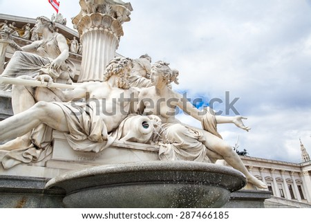 Pallas Athena fountain, in front of the Austrian Parliament Building. The figures symbolize the rivers Danube, Inn, Elbe and Moldau. Vienna, Austria, Europe. - stock photo
