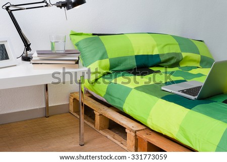 Pallet bed diy in modern bedroom with laptop