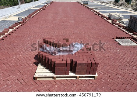 pallet of cobbles at construction site in residential zone