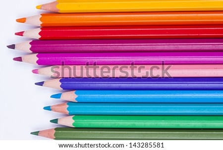 Pallet of colourful crayons on white background.