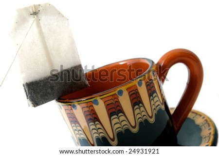 Palletised tea and ceramic cup on white background
